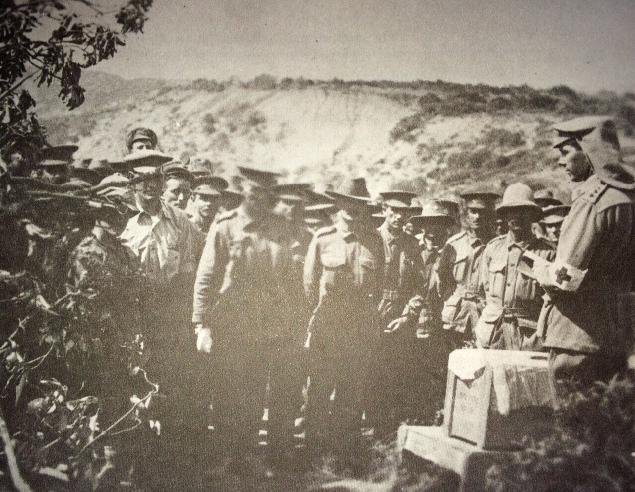 Chaplain Colonel Merrington ministering to First AIF troops on the Gallipoli Peninsula in 1915.